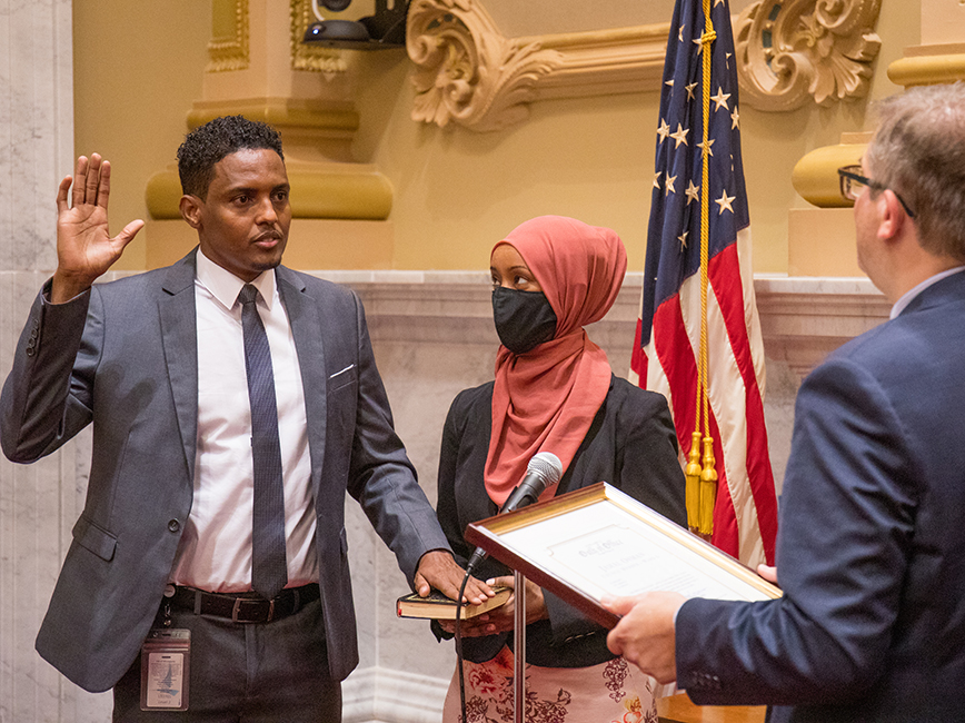 Council Member Jamal Osman takes his oath of office with his wife by his side.
