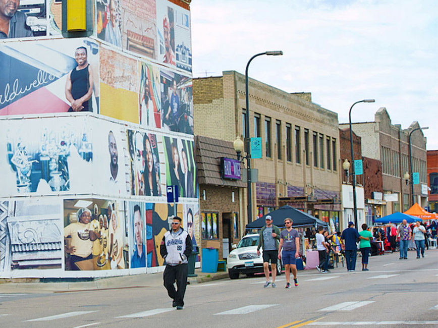 People walking through Open Streets Minneapolis 2019 in North Minneapolis.